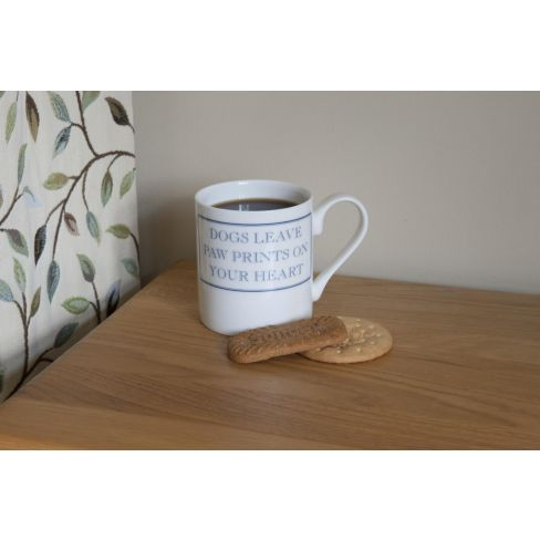 Dogs leave paw prints on your heart mug