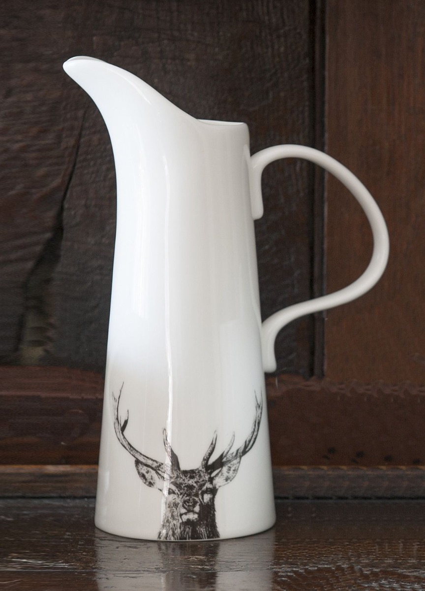 The Majestic Stag Jug placed on a wooden surface.
