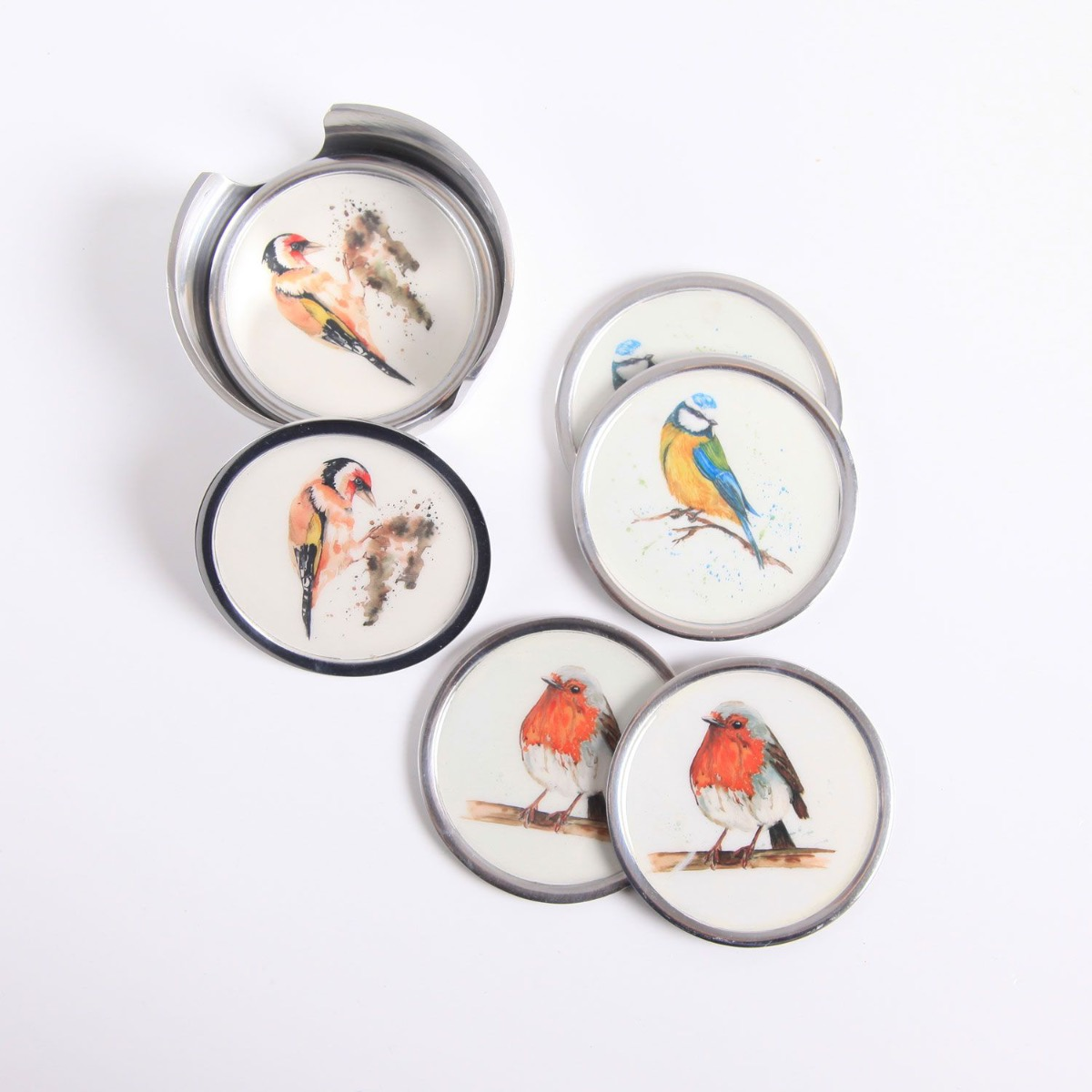 A selection of Garden Birds Coasters scattered on a white surface.