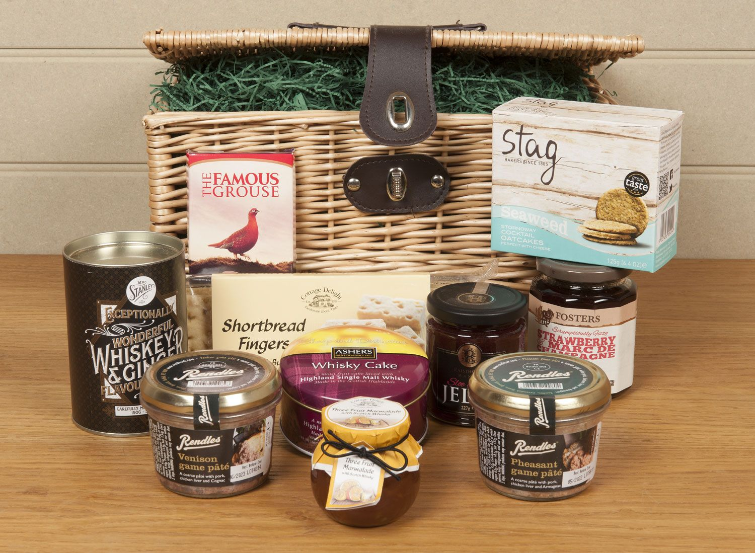 Our Highland Hamper with some of the contents placed on a wooden table