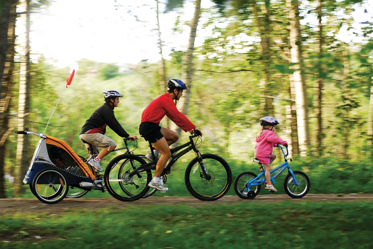 family cycling through the woods