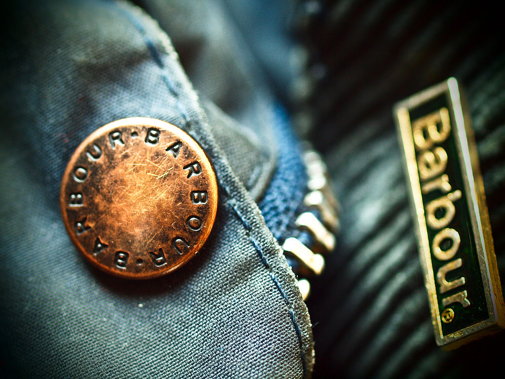 Macro shot of Barbour jacket showing the Barbour logo