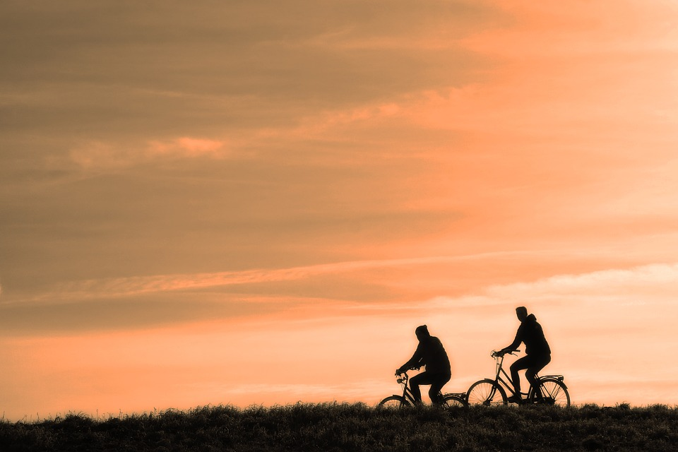 People cycling through the countryside