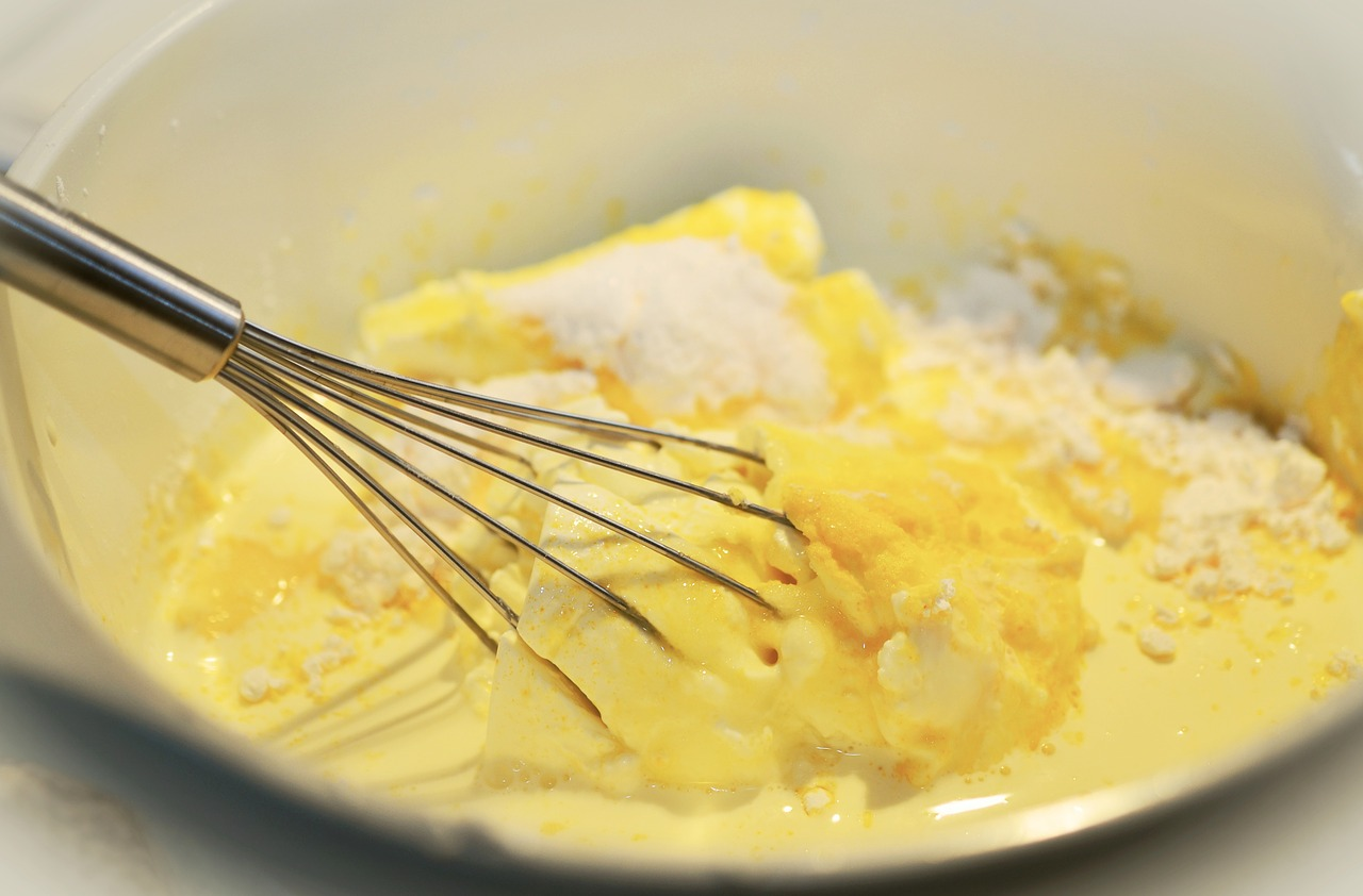A cake mixture containing butter, sugar, lemon zest and eggs