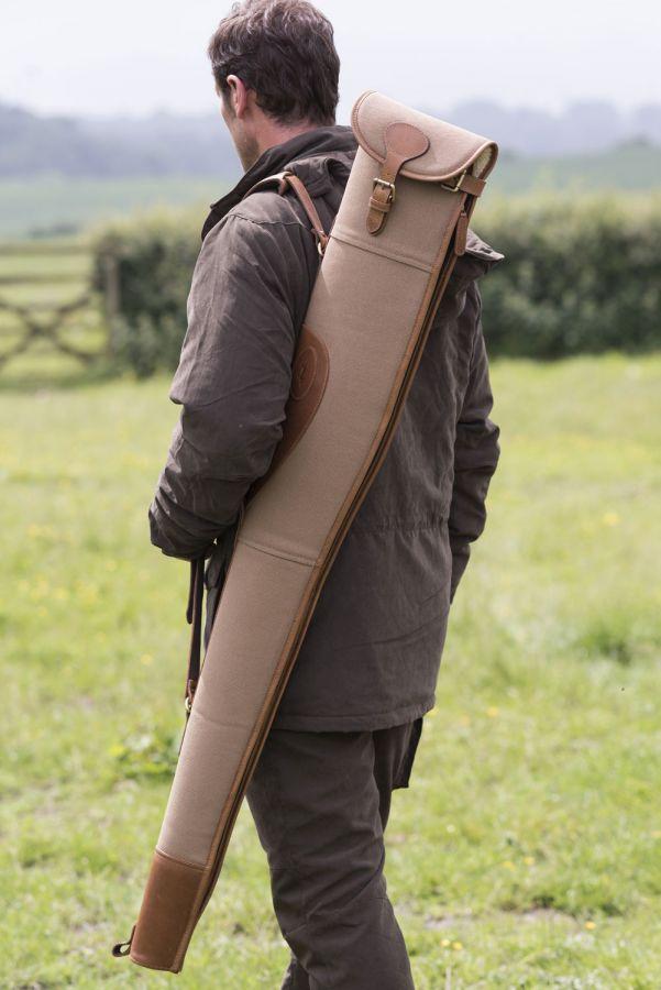 Man using a Fur Feather & Fin gunslip to hold his gun