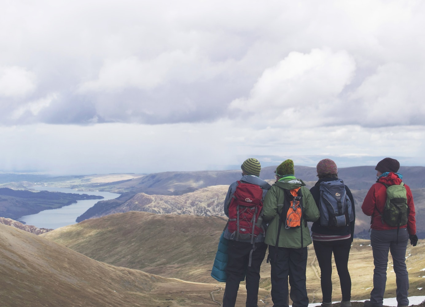 Four walkers looking over Helvellyn in the Lake District