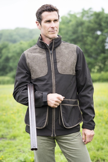 A man holding a shotgun wearing our Seeland Men's Winster Softshell Jacket.