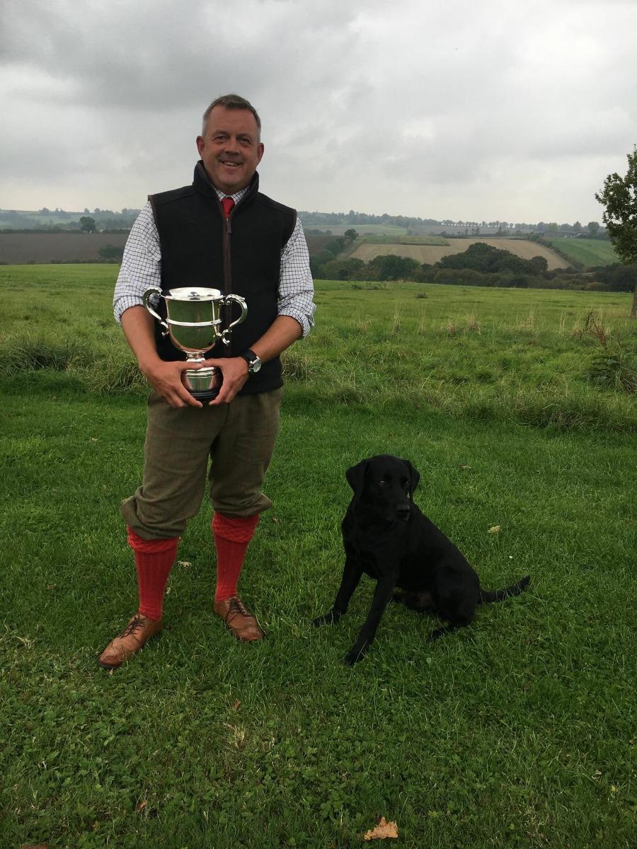 Jason Mayhew with an award