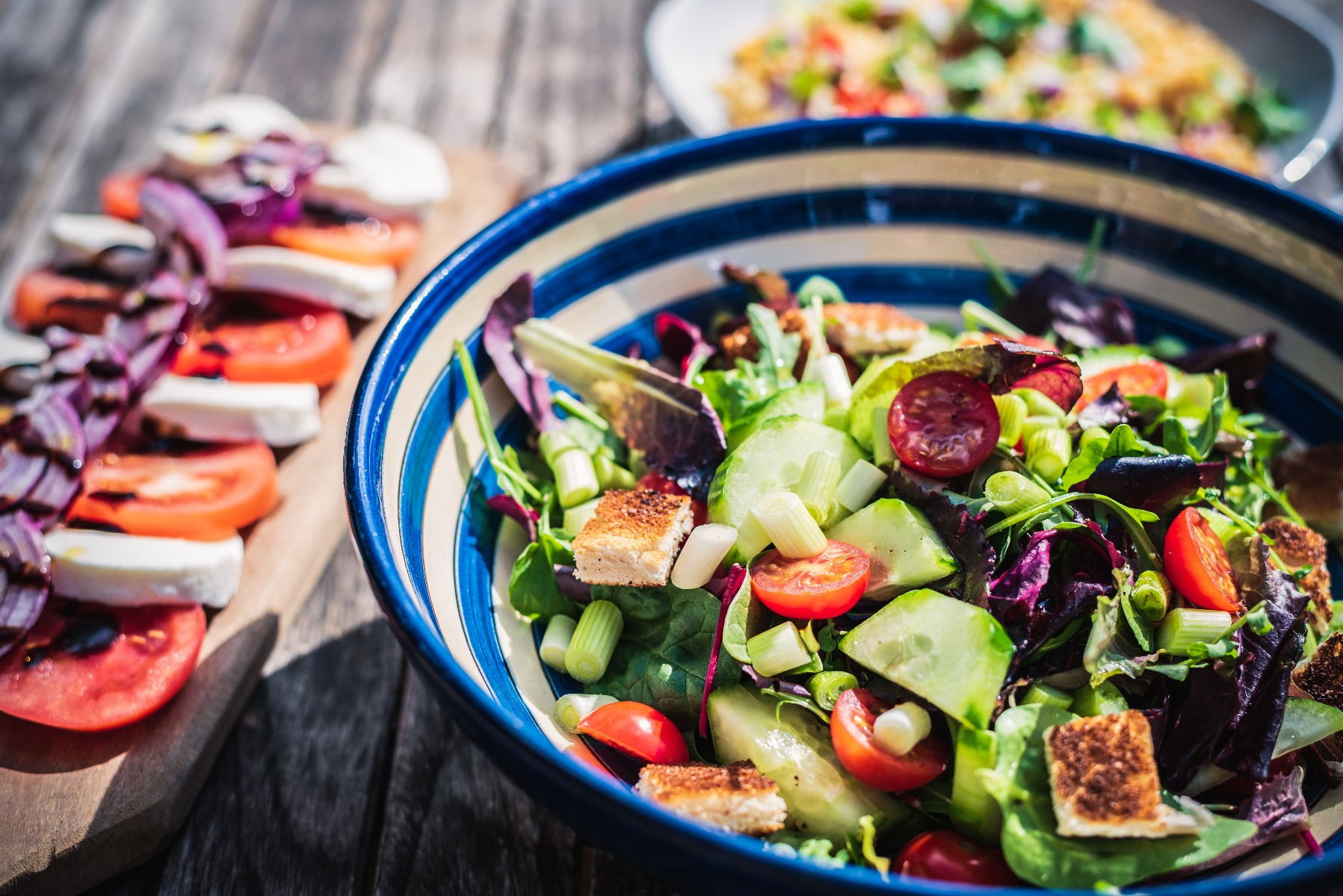 blue and white bowl with green salad