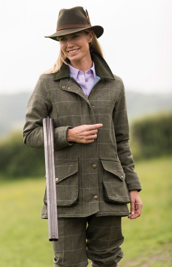 Lady shooter in a tweed coat