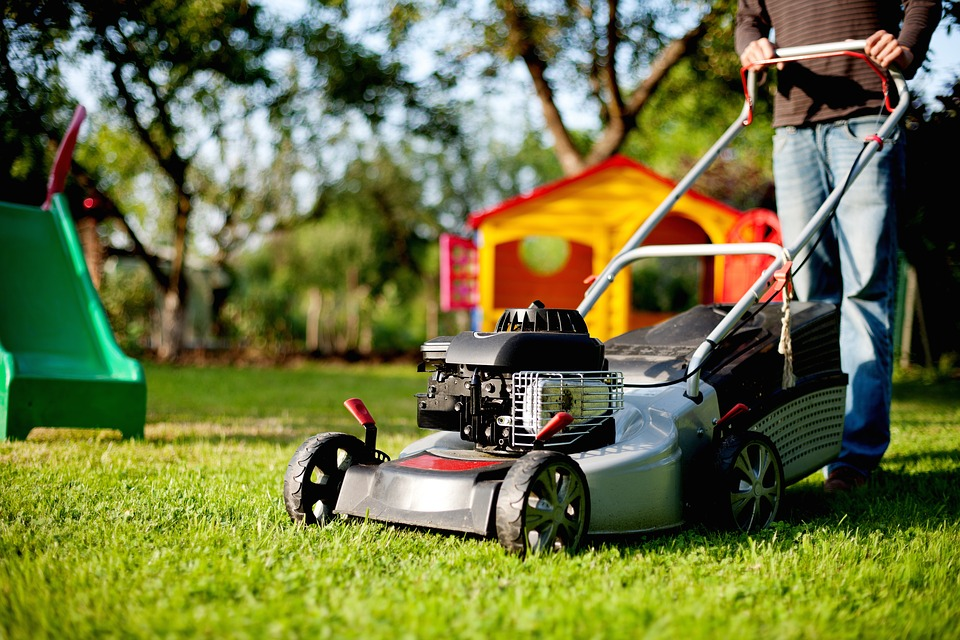 Lawn mover in British garden
