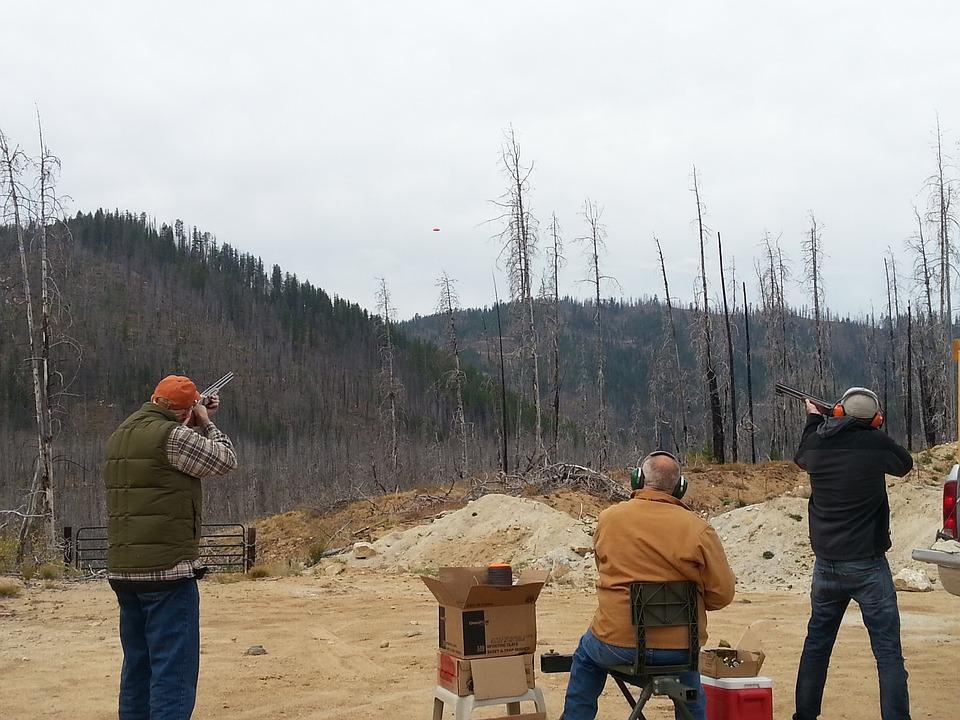 3 men sat clay pigeon shooting