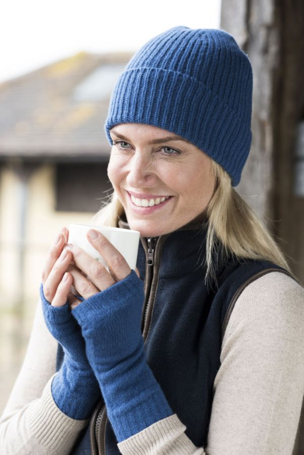 Woman wearing blue wrist warmers